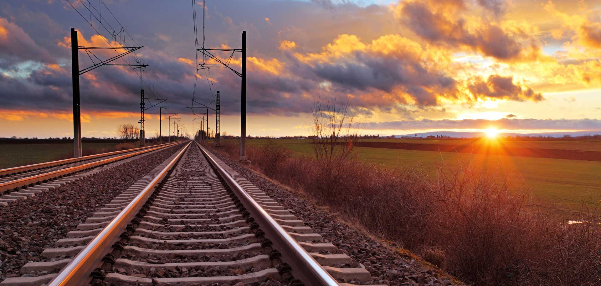 Railway tracks with sunset in background