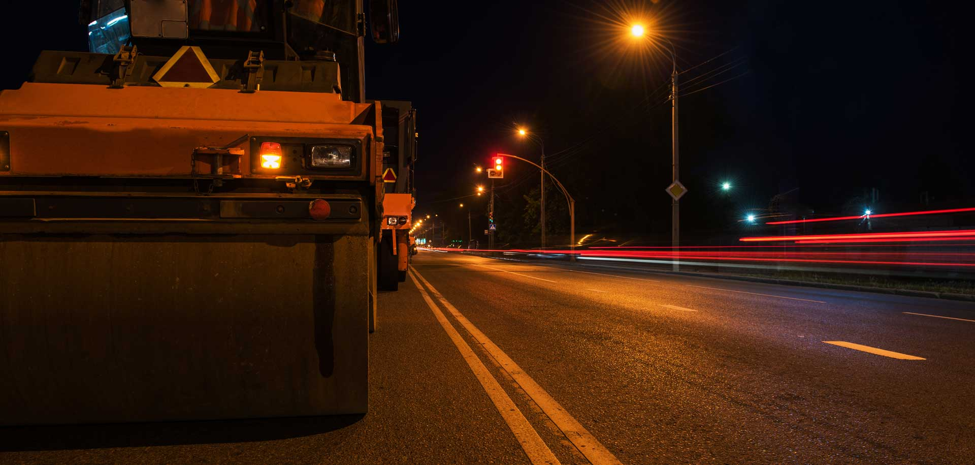 Trucks on road at night