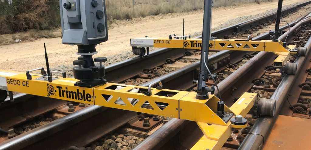 Surveying device on tracks