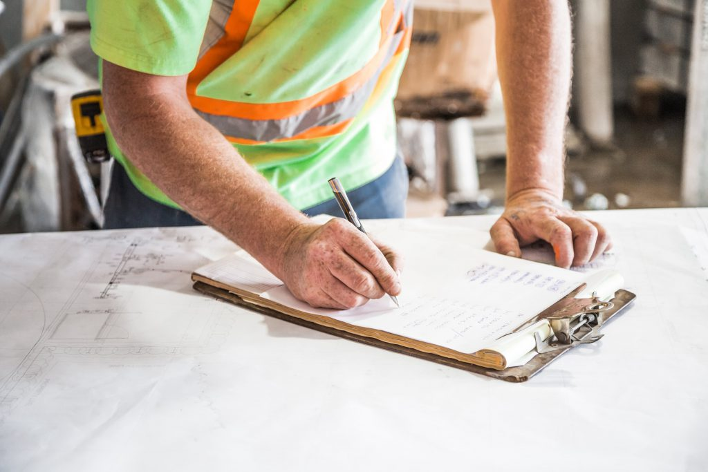 construction man writing on paper